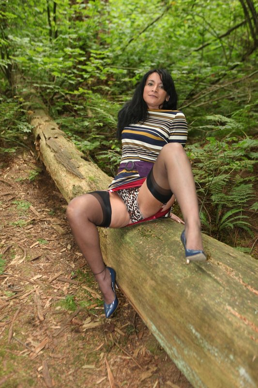 Gigantic arse mature demonstrates off her girdle in the forest