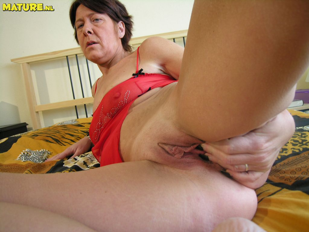 Super-naughty mature whore toying with her labia